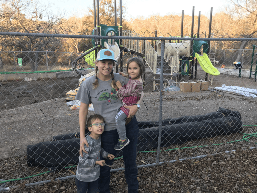Frannie and kids in front of new playscape at Gracywoods
