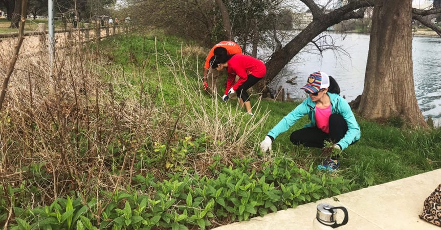 Volunteers picking up trash near the Colorado River