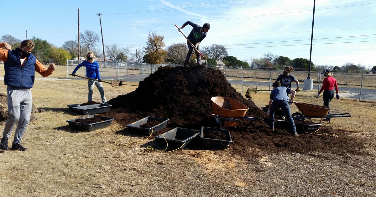 barry and volunteers mulching outdoor classroom