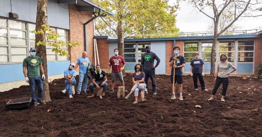 volunteers build outdoor classroom