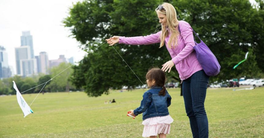 mom and daugther flying kite at zilker