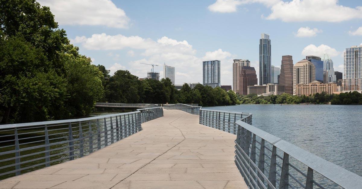 boardwalk at lady bird lake paved trail city view